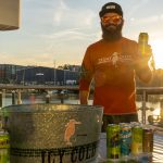 A Stony Creek IPA Representative posing with a beer can