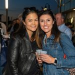 Two women posing for a photo at the 2019 Stamford Brew and Whiskey Festival