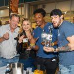 Patrons posing for a photo with the Suntory Whiskey bottles at the 2019 Stamford Brew and Whiskey Festival