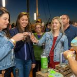 Three women cheering to shots at the 2019 Stamford Brew and Whiskey Festival